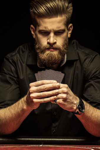man holding cards